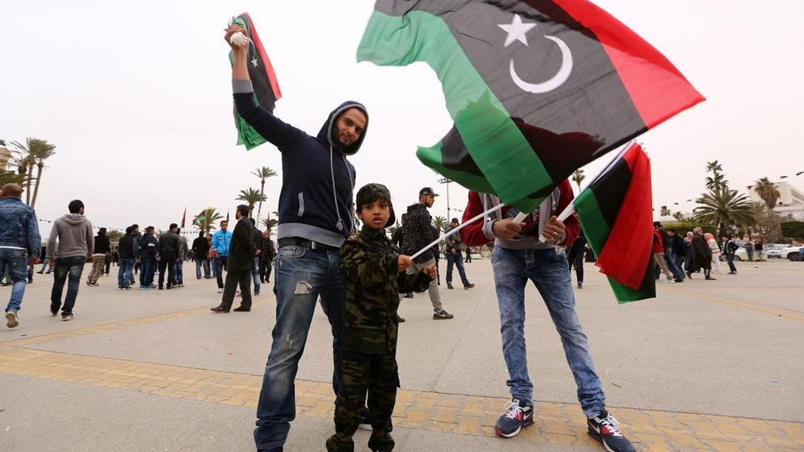 Libyans wave national flags as they gather at Martyrs' Square in the capital Tripoli on February 16, 2016 to attend the celebrations marking the fifth anniversary of the Libyan revolution which toppled strongman Moamer Kadhafi. Five years after the death of dictator Moamer Kadhafi, many Libyans have lost hope of seeing the rule of law return to a divided country threatened by jihadist expansion. / AFP / MAHMUD TURKIA