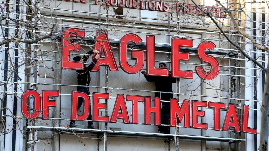 Workers set up ahead a Tuesday's concert by Eagles of Death Metal, at the Olympia music hall, in Paris, Tuesday, Feb. 16, 2016. AP