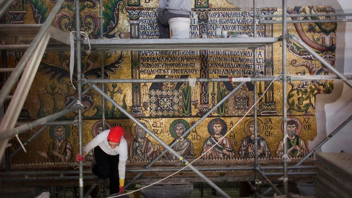 Restoration experts work on mosaic inside the Church of the Nativity, in the West Bank city of Bethlehem. (AP)