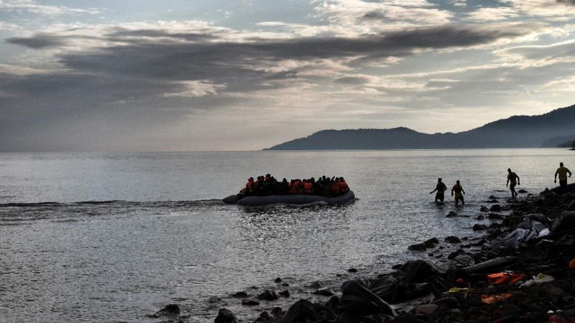 Refugees and migrants arrive on the Greek island of Lesbos on a dinghy on November 10, 2015 (AFP)