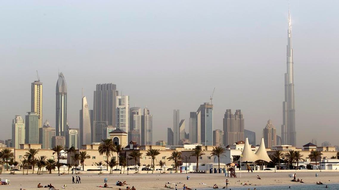 In this photo dated Thursday, July 26, 2012, people enjoy swimming at Jumeirah open beach with the city skyline in background, Dubai, United Arab Emirates. (AP)