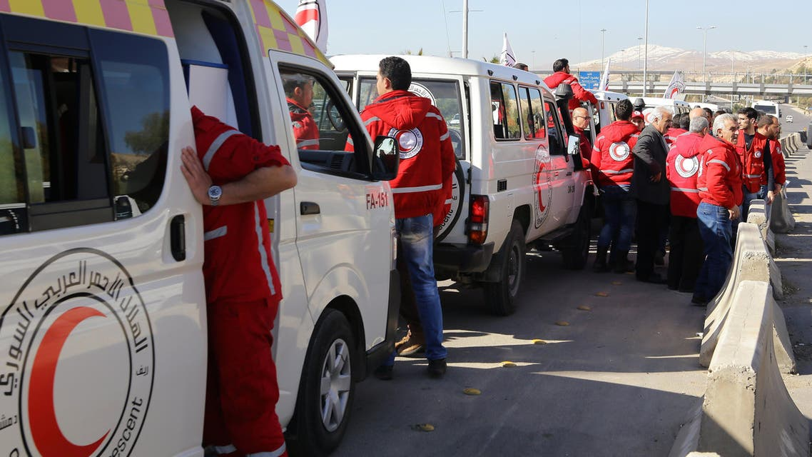 DAM873 - Damascus : A Red Crescent convoy prepares to leave Damascus to the besieged areas of Madaya and Zabadani, on February 17, 2016 during an operation in cooperation with the UN to deliver aid to thousands of besieged Syrians. Almost half a million people in Syria are in areas under seige, according to the United Nations, after almost five years of civil war between Syria's government and rebel forces.