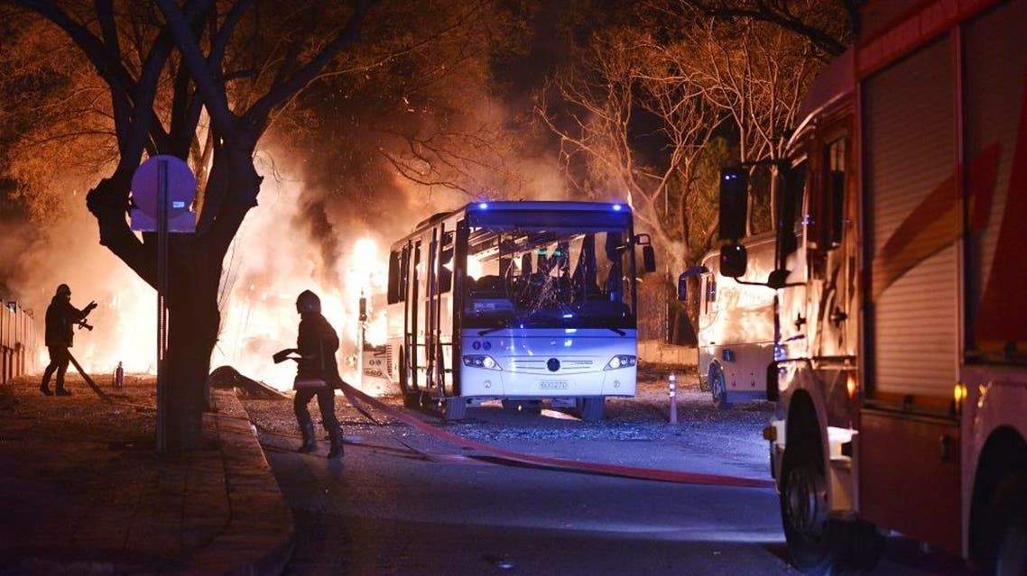 Firefighters work at a scene of fire from an explosion in Ankara, Wednesday, Feb. 17, 2016. A large explosion, believed to have been caused by a bomb, injured several people in the Turkish capital on Wednesday, according to media reports. Private NTV said the explosion occurred during rush hour in an area close to where military headquarters are located as a bus carrying military personnel was passing by. Several cars caught fire, the report said. Ambulances were seen rushing toward the scene. The explosion caused a large fire and dark smoke could be seen billowing from a distance. (IHA via AP)
