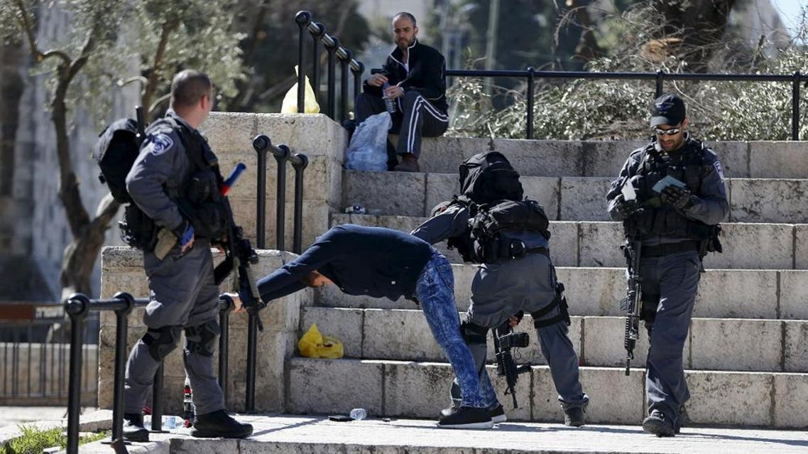 Israeli police perform a body search on a Palestinian man at Damascus Gate in Jerusalem's Old City February 16, 2016. REUTERS/Ammar Awad