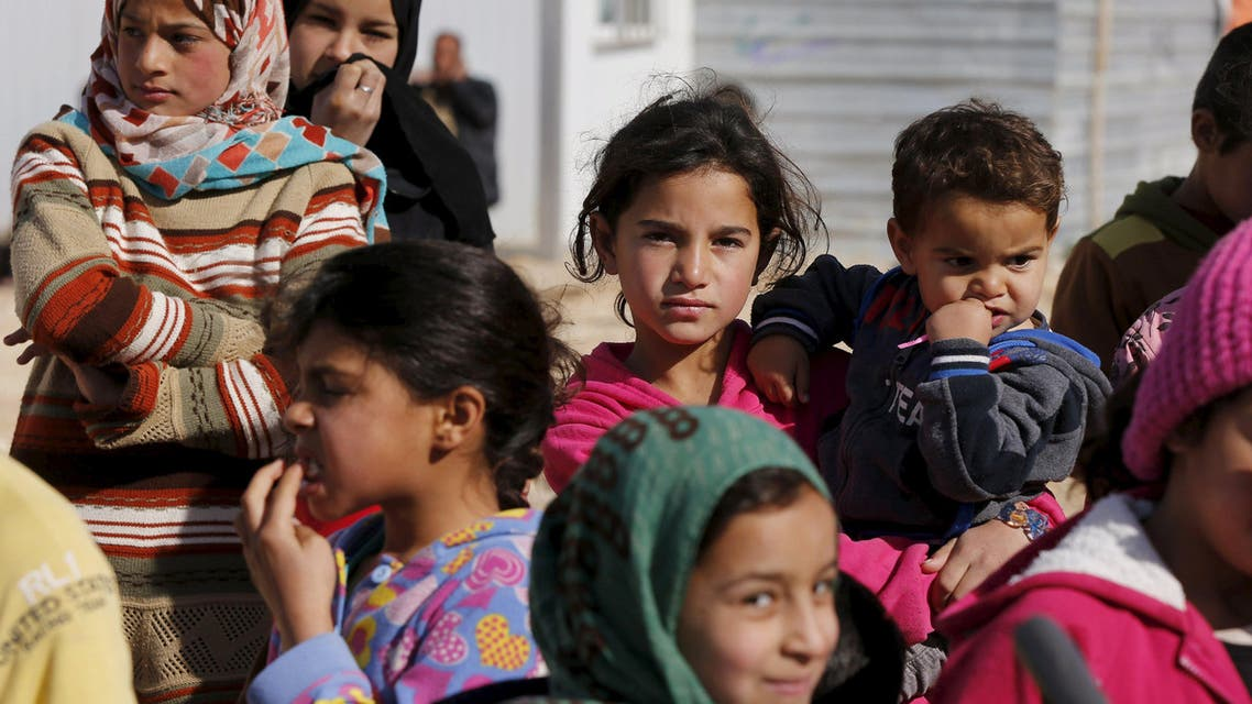Syrian refugee children watch as Britain's Foreign Secretary Philip Hammond visits Al Zaatari refugee camp in the Jordanian city of Mafraq, near the border with Syria, February 1, 2016. REUTERS/