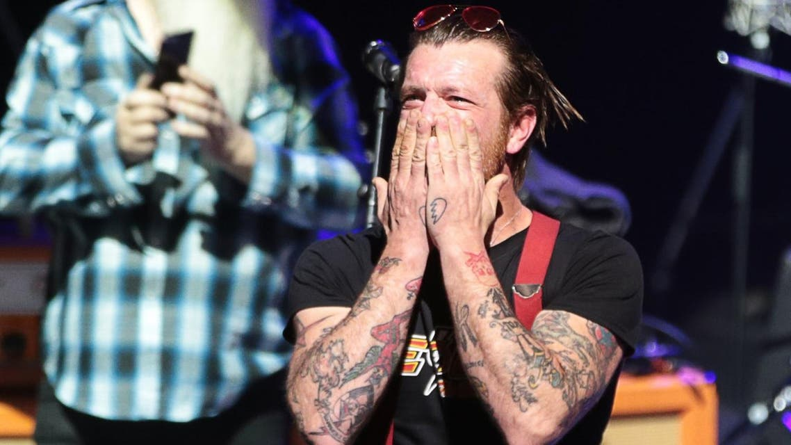 Jesse Hughes (R), the singer of US rock group Eagles of Death Metal, blows a kiss before the start of the concert at the Olympia concert hall in Paris. (AFP)
