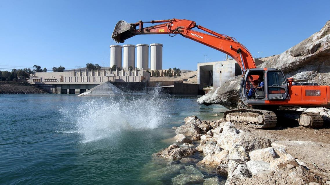 Employees work at strengthening the Mosul Dam. (Reuters)
