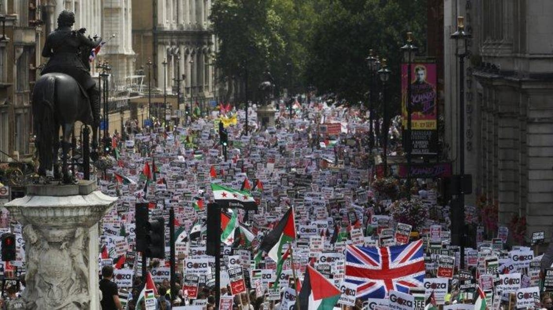 Demonstrators protest against Israel's military action in Gaza, in Whitehall, London, July 19, 2014. The British government is to ban local authorities and public sector organizations from boycotting Israeli suppliers.