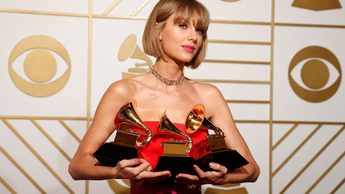 Taylor Swift poses with her awards during the 58th Grammy Awards in Los Angeles. (Reuters)