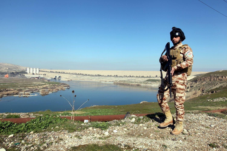 An Iraqi Kurdish Peshmerga stands guard near the Mosul Dam. (Reuters)