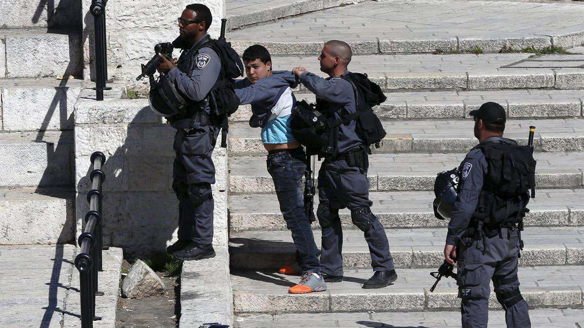 Israeli border policemen perform a body search on a Palestinian youth at Damascus Gate in Jerusalem's Old City February 17, 2016. REUTERS/Ammar Awad