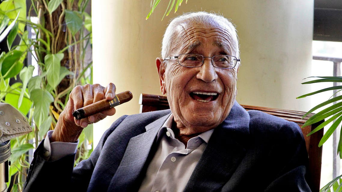 In this Sept. 19, 2015 photo, Mohamed Heikal jokes with friends days before his 92nd birthday at his house, in Cairo, Egypt. (AP)