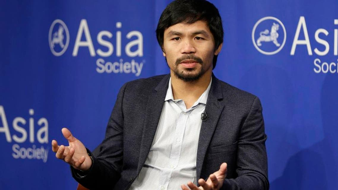 """In this Oct. 12, 2015, file photo, Manny Pacquiao takes questions at the Asia Society in New York. Boxing star Pacquiao has created a firestorm in his home country after saying people in same-sex relationships """"are worse than animals."""" Pacquiao, who is running for a Philippine Senate seat, made the remark in a video posted Monday, Feb. 15, 2016, on local TV5's election site. He also said animals are better than people in same-sex relationships because they recognize the difference between males and females. (AP Photo/Seth Wenig, File)"""