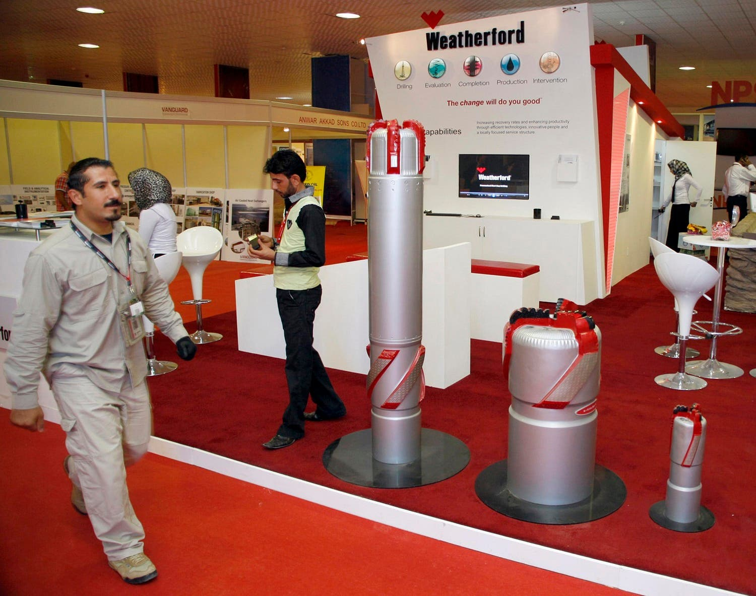 A security guard walks past the Weatherford booth during the Basra International trade fair for oil and gas in Basra, Iraq in a November 25, 2010 file photo. (Reuters)