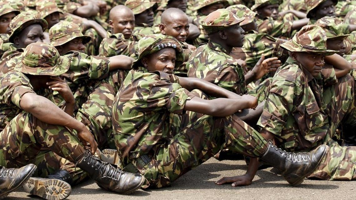 Members of the Kenya Defence Forces attend prayers as they pay their respects to the Kenyan soldiers serving in the African Union Mission in Somalia (AMISOM), who were killed in El Adde during an attack, at a memorial mass at the Moi Barracks in Eldoret, January 27, 2016. Al Shabaab, which is aligned with al Qaeda, said its fighters killed more than 100 Kenyan soldiers when they overrun the base in El Adde, also known as Ceel Cadde, near the Kenyan border, on Jan 15. REUTERS/Thomas Mukoya