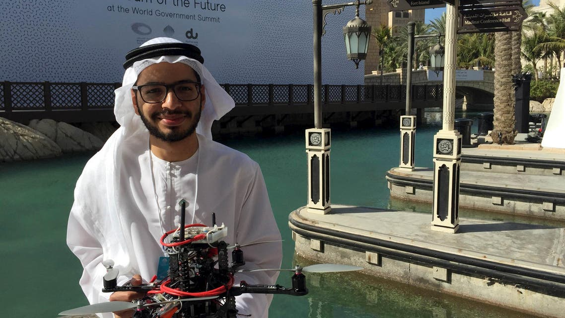 """Emirati Ph.D student Talib alHinai poses with the drone prototype he and his classmates at Imperial College London built, which won a prize at state-sponsored """"Drones for Good"""" competition, in Dubai February 10, 2016. REUTERS"""