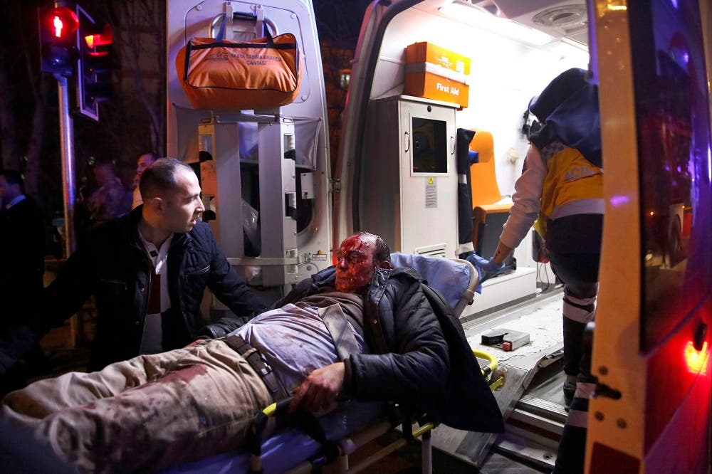 Paramedics carry a wounded man from the site of an explosion into an ambulance in Ankara, Wednesday, Feb. 17, 2016. Assailants on Wednesday exploded a car bomb near vehicles carrying military personnel in the Turkish capital, killing at least 18 people and wounding some 45 others, officials said. (Mustafa Kirazli/Cihan News Agency via AP)