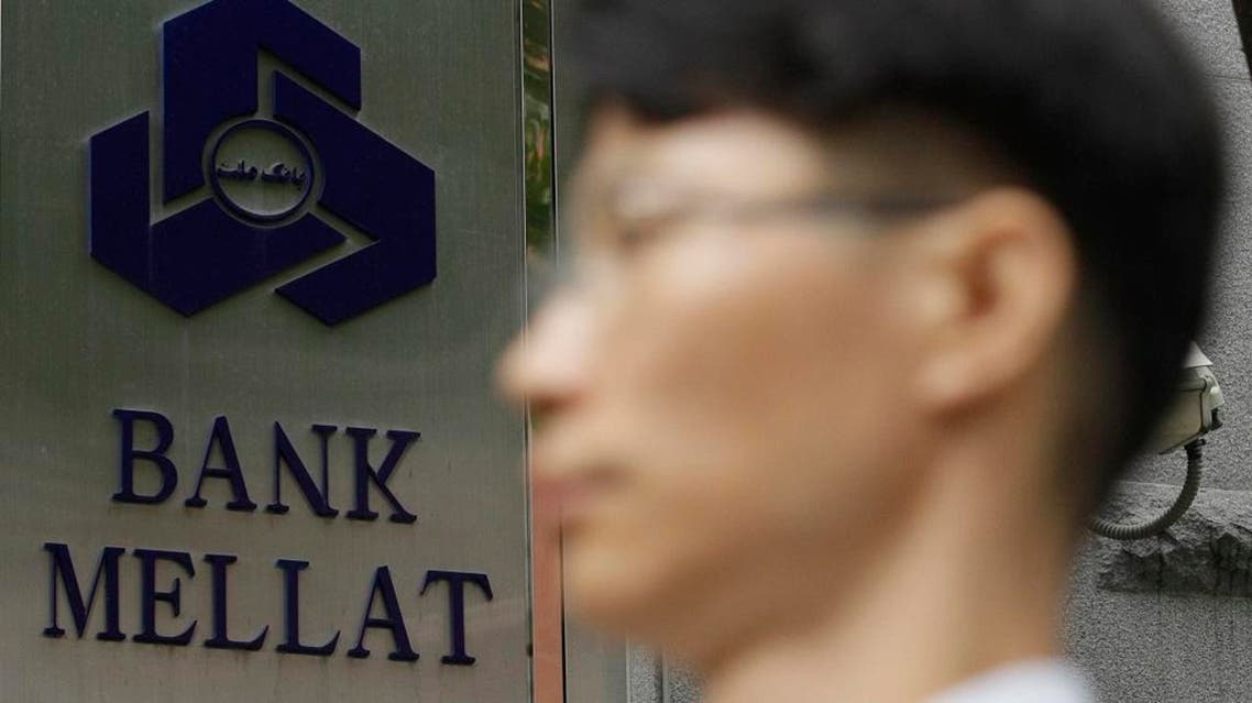 A South Korean man walks by a signboard of the Iranian Bank Mellat Seoul branch in Seoul, South Korea, Wednesday, Sept. 8, 2010. South Korea said Wednesday it will ban unauthorized financial dealings with Iran as part of sanctions to join the U.S-led campaign to tighten restrictions against Tehran over its disputed nuclear enrichment program. South Korea also said it will heavily penalize the Seoul branch of Bank Mellat, one of the 15 blacklisted Iranian banks, for violations of laws on foreign exchange transactions, a government statement said without elaborating on the penalty. (AP Photo/ Lee Jin-man)
