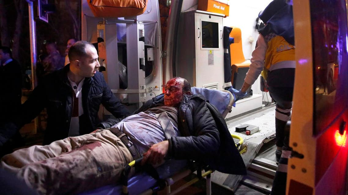 Paramedics carry a wounded man from the site of an explosion into an ambulance in Ankara. (AP)