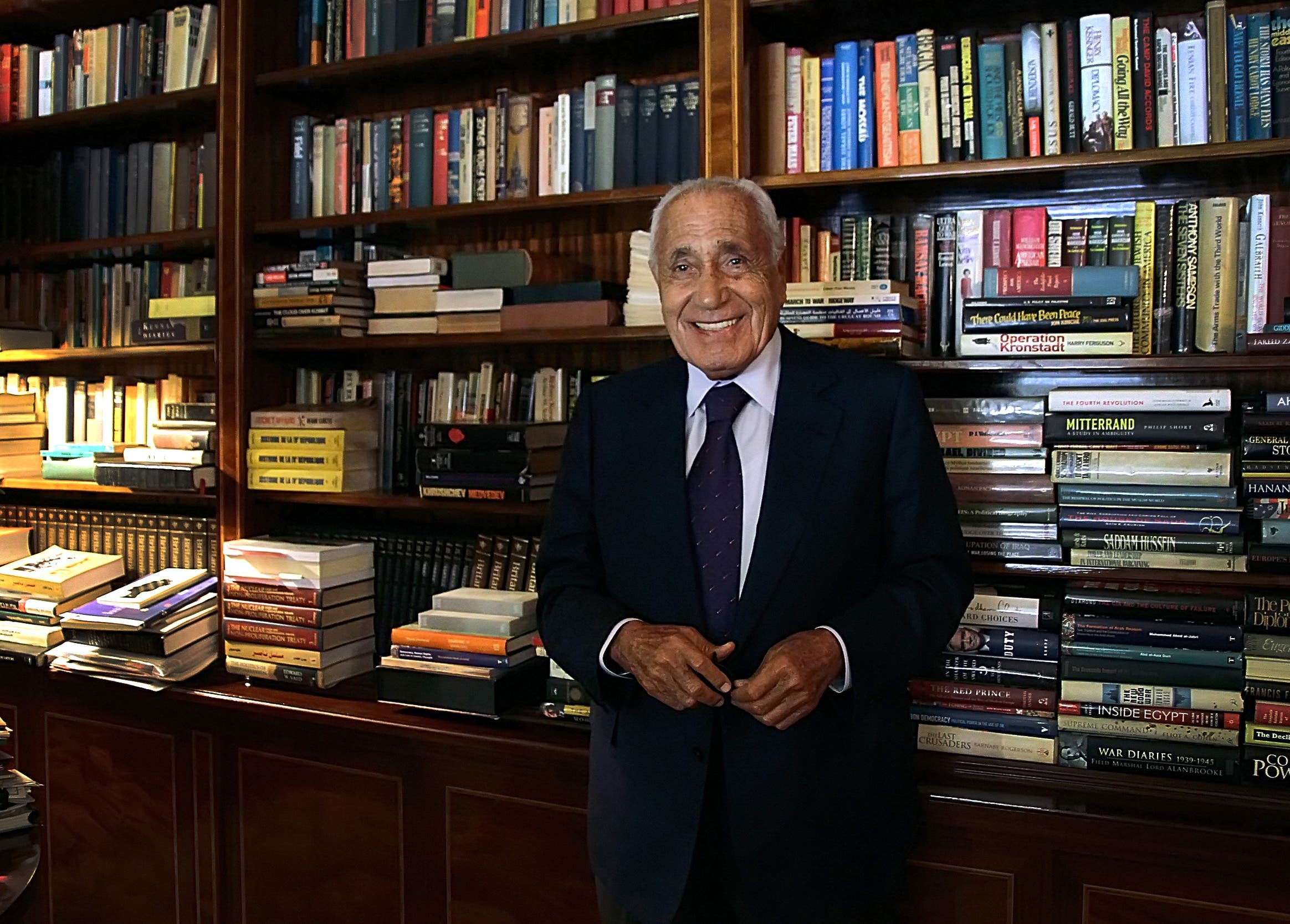 In this Sept. 23, 2014 photo, Mohamed Heikal poses for a picture on his 91st birthday, at his office, in Cairo, Egypt. AP