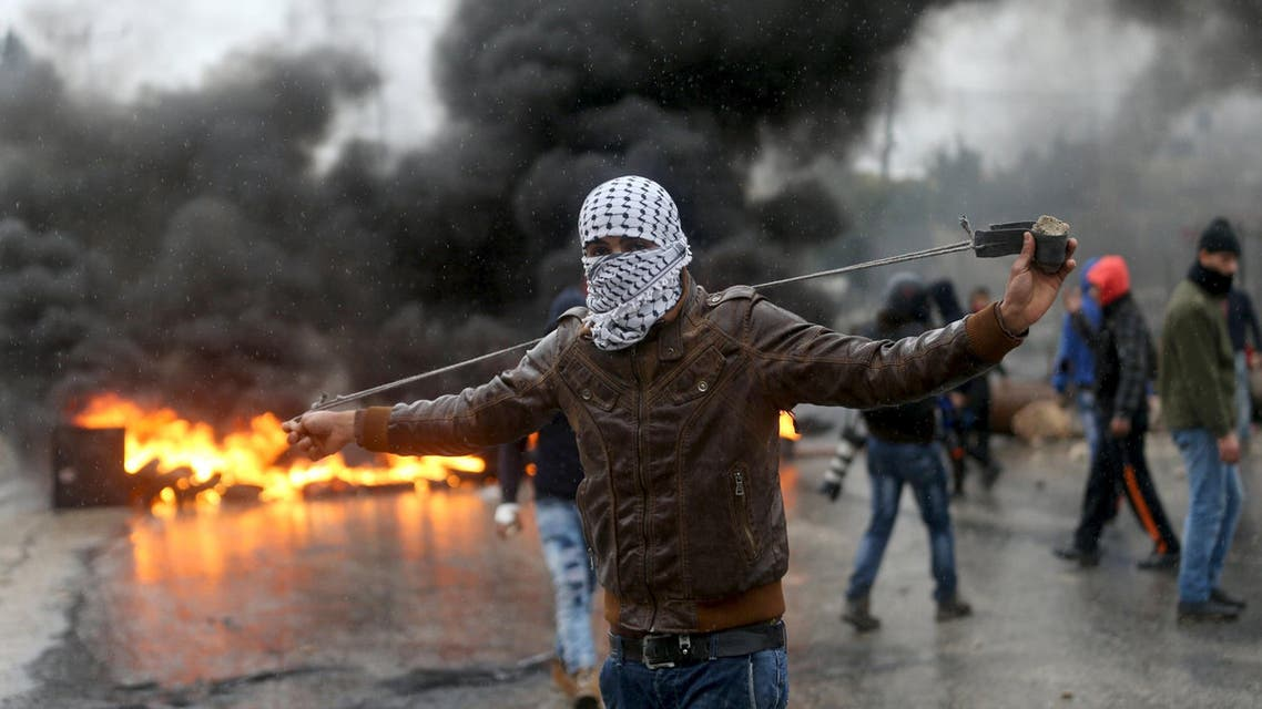 A Palestinian protester prepares his sling to hurl stones towards Israeli troops during clashes in the West Bank town of Qabatya, near Jenin February 6, 2016. On Wednesday, three young Palestinian men from Qabatya wielding guns, knives and pipe-bombs killed a paramilitary Israeli policewoman in Jerusalem and were shot dead. In response, Israeli forces raided the assailants' hometown, arresting five suspected militants and imposing a closure. REUTERS/Mohamad Torokman TPX IMAGES OF THE DAY