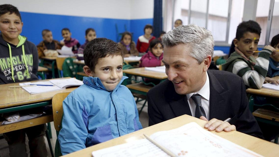 New United Nations High Commissioner for Refugees (UNHCR) Filippo Grandi smiles at a Syrian refugee boy inside a classroom in Beirut, during his visit to Lebanon, January 20, 2016. REUTERS