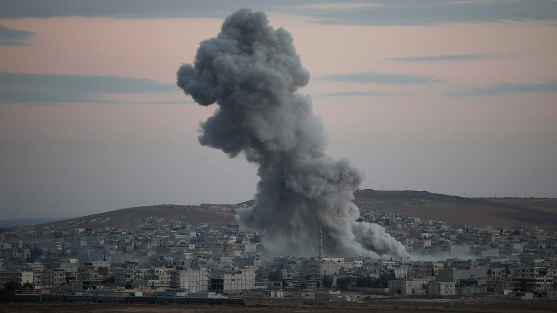 Thick smoke from an airstrike by the US-led coalition rises in Kobani, Syria while fighting continued between Syrian Kurds and the militants of Islamic State group, as seen from Mursitpinar on the outskirts of Suruc, at the Turkey-Syria border, Saturday, Oct. 18, 2014. AP