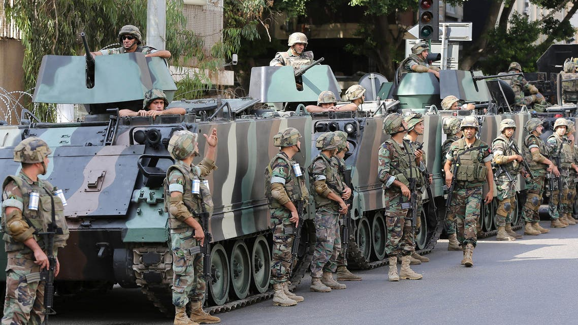 Lebanese army soldiers stand next to their armored personnel carriers, as they guard the building of the Russian embassy, during a sit-in by the Islamic Scholars against Russian intervention in Syria, in Beirut, Lebanon, Wednesday, Oct. 14, 2015.  (AP)