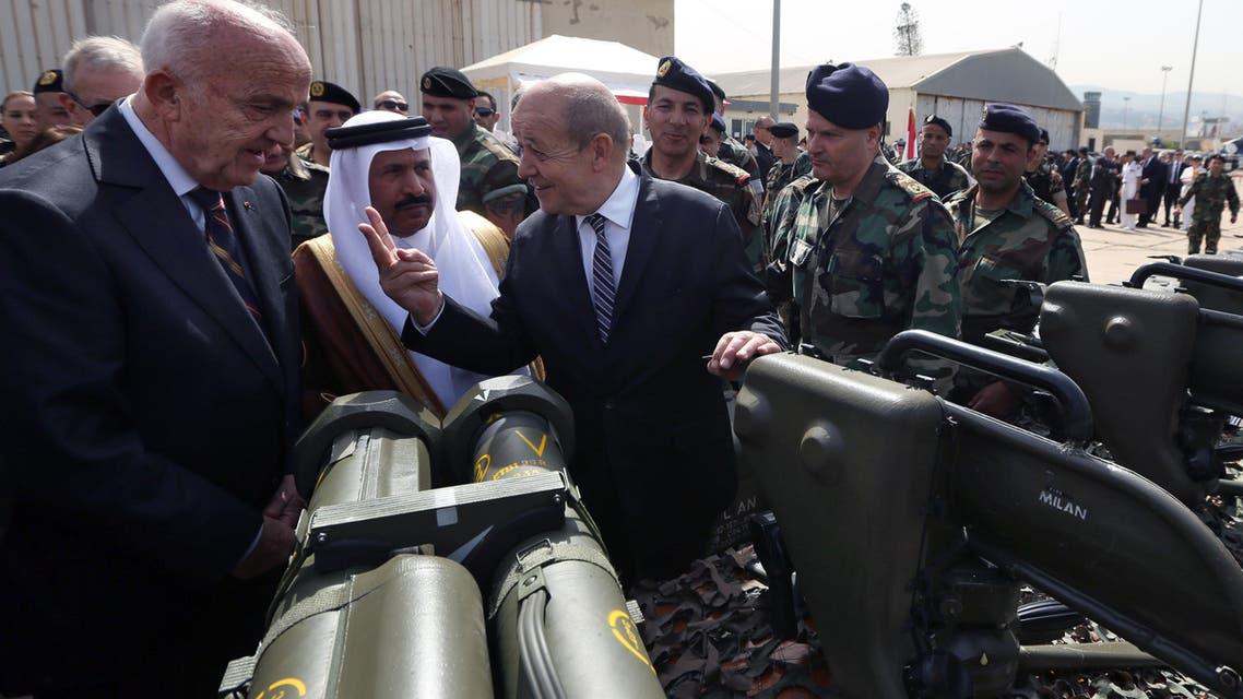 French Defense Minister Jean-Yves Le Drian, center, speaks with Lebanese Defense Minister Samir Moqbel, left, as Saudi Ambassador to Lebanon Ali Awad Assiri, second left, seen in Beirut, Lebanon, Monday, April 20, 2015