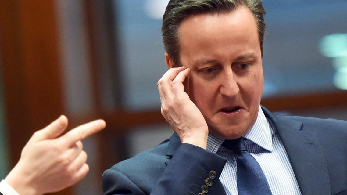 Estonian Prime Minister Taavi Roivas points while speaking with British Prime Minister David Cameron, right, during a round table meeting at an EU summit in Brussels on Thursday, Feb. 18, 2016. (AP)