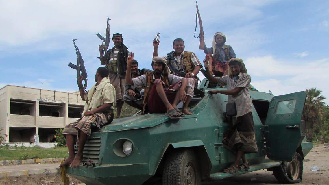 In this photo taken on Friday, March 20, 2015, militiamen loyal to President Abed Rabbo Mansour Hadi ride on an army vehicle on a street in Aden, Yemen. AP