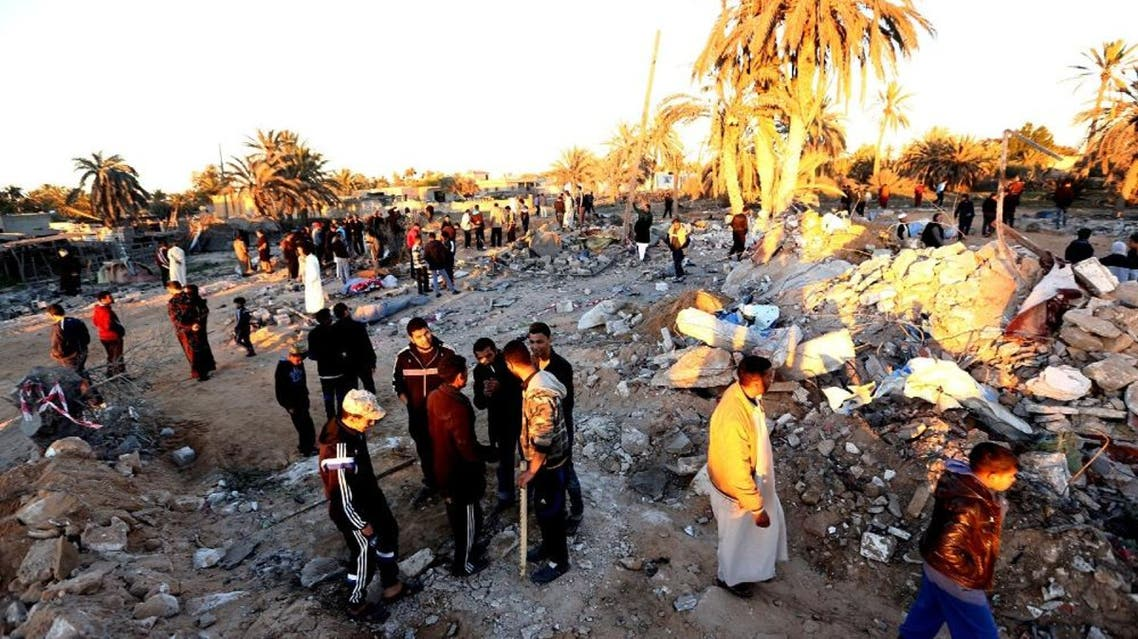 Libyans gather next to debris at the site of a jihadist training camp, targeted in a US air strike, near the Libyan city of Sabratha on February 19, 2016 (AFP)