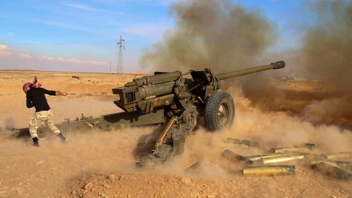 In this photo taken on Saturday, Jan. 30, 2016, Syrian government troops fire at Islamic State group positions near Mahin, Syria.