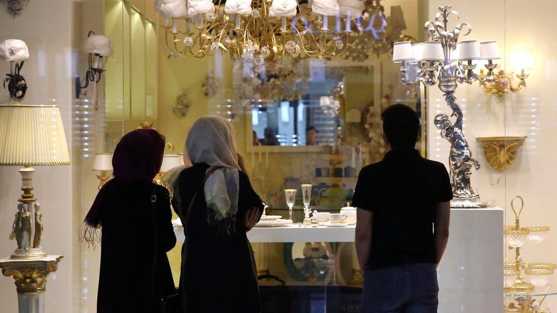 Iranians go window shopping at the Palladium shopping center in northern Tehran, Iran, Saturday, July 18, 2015. (AP)