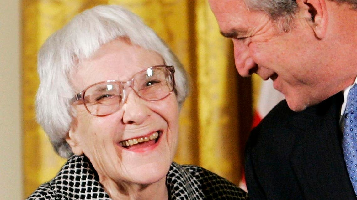 U.S. President George W. Bush (R) before awarding the Presidential Medal of Freedom to American novelist Harper Lee (L) in the East Room of the White House, in this November 5, 2007, file photo. Reuters