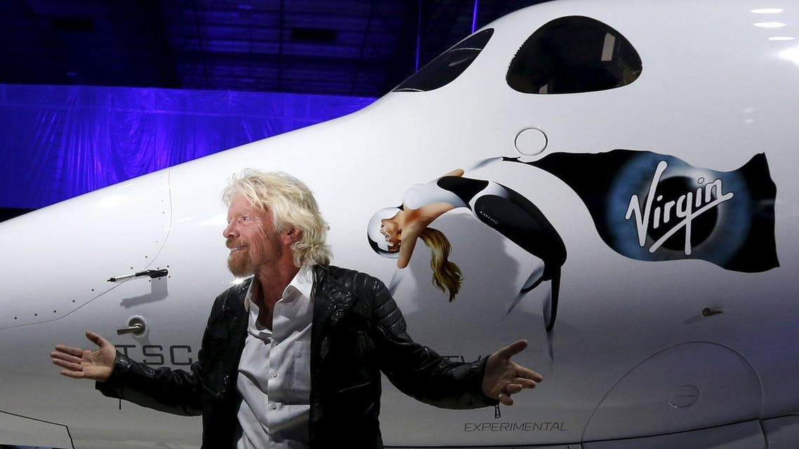 Richard Branson poses after unveiling the new SpaceShipTwo, a six-passenger two-pilot vehicle meant to ferry people into space that replaces a rocket destroyed during a test flight in October 2014, in Mojave. (Reuters)
