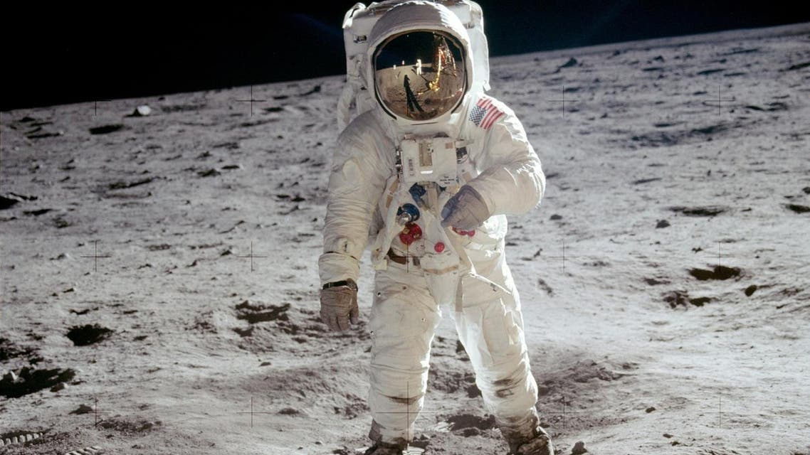 """The reflections of Astronaut Neil Armstrong, the U.S. Flag, the Lunar Module and television camera, are reflected in the face mask of Astronaut Edwin """"Buzz"""" Aldrin when his picture was taken by Armstrong as they walked across the surface of the moon, July 31, 1969. AP"""
