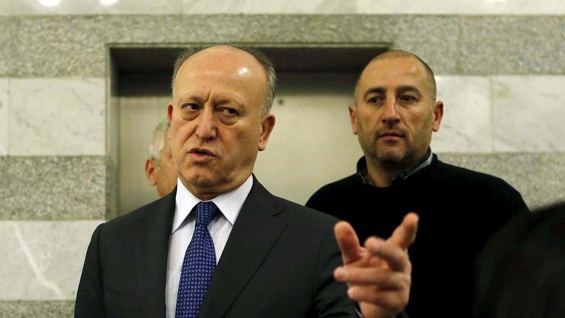Lebanon's Justice Minister Ashraf Rifi gestures upon his arrival to attend a Cabinet session at the government palace in Beirut, January 22, 2015. Rifi on February 21, 2016 announced his resignation, blaming political rivals Hezbollah and their allies for the country's political crisis, which has seen it without a president for 21 months and paralysed state institutions. Picture taken January 22, 2015. REUTERS