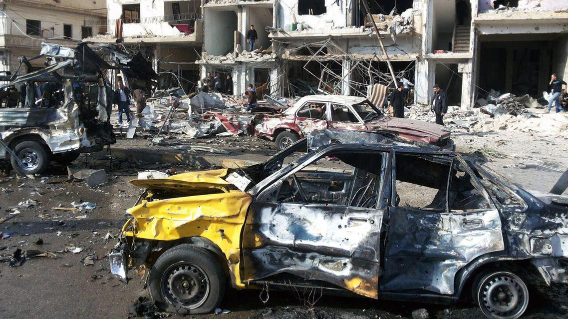 In this photo released by the Syrian official news agency SANA, Syrian citizens gather at the scene where two blasts exploded in the pro-government neighborhood of Zahraa, in Homs province, Syria, Sunday, Feb. 21, 2016. AP