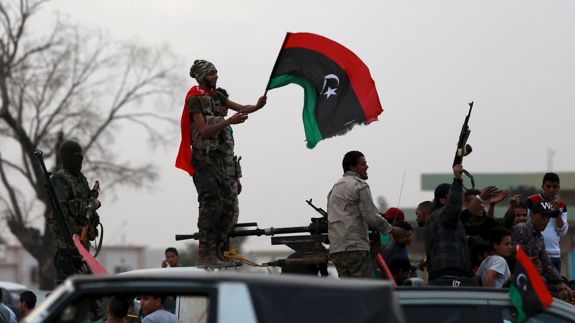 Armed Libyan men wave their national flags in celebrations marking the fifth anniversary of the Libyan revolution, in Benghazi, Libya February 17, 2016. REUTERS