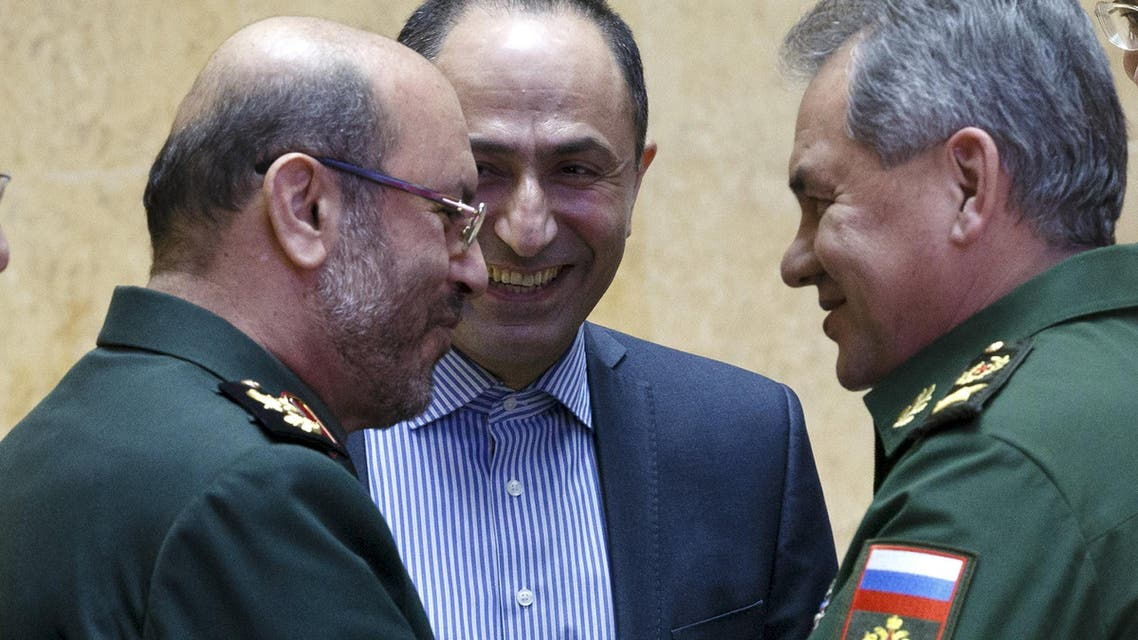 Russian Defense Minister Sergei Shoigu (R) and his Iranian counterpart Hossein Dehghan (L) shake hands during their meeting in Moscow, Russia, February 16, 2016 in this handout provided by Russian Defence Ministry. reuters