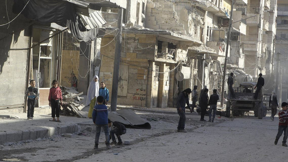 Residents inspect damage after an airstrike on the rebel held al-Fardous neighbourhood of Aleppo, Syria February 18, 2016. REUTERS