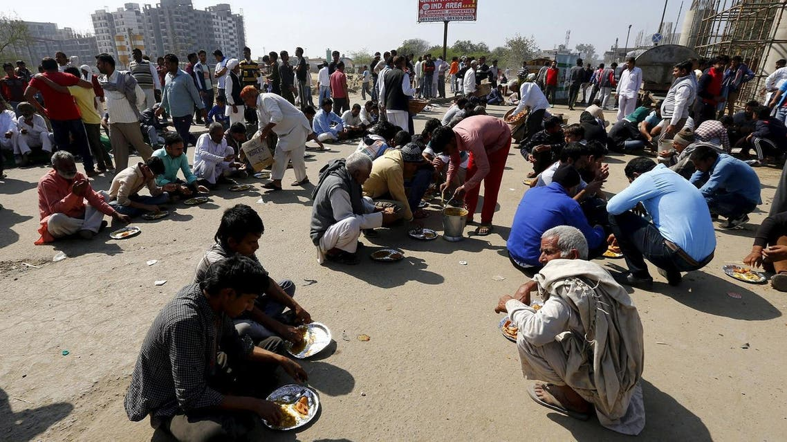 Demonstrators from the Jat community eat as they block the Delhi-Haryana national highway during a protest in New Delhi, India, February 21, 2016. Reuters