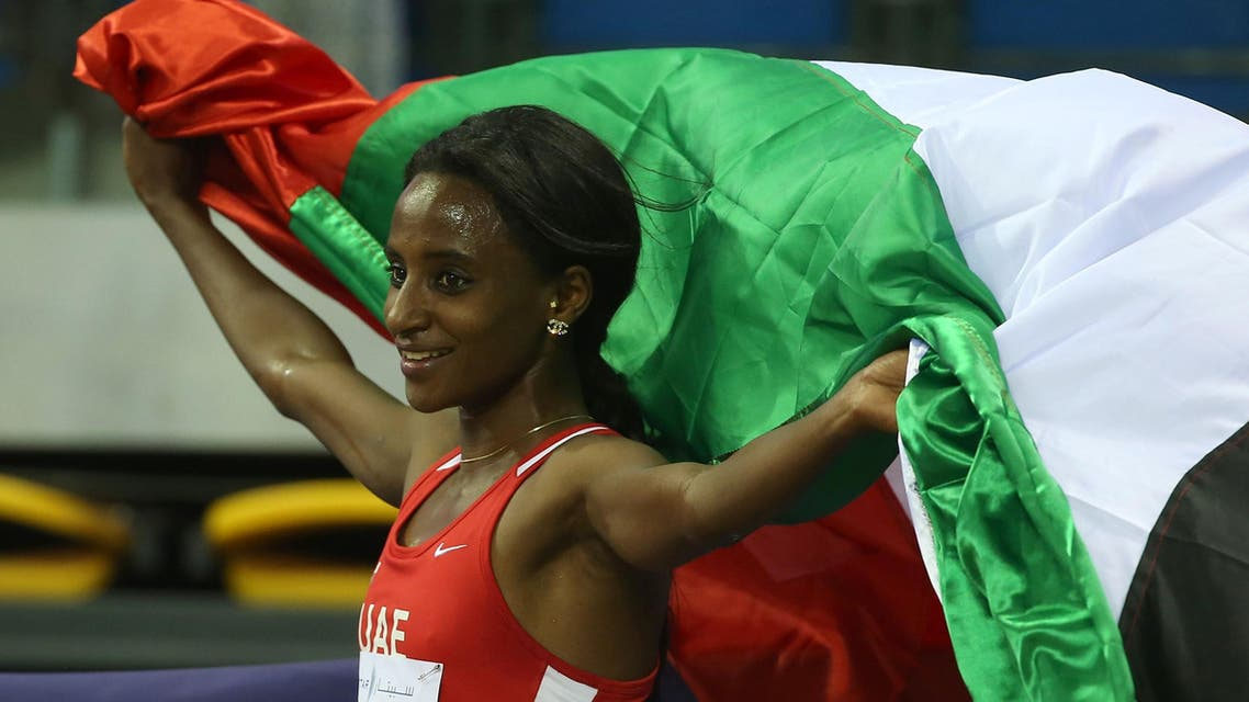 UAE's Bethlem Desalegn celebrates winning the 3000m Women's final during the seventh Asian Indoor Athletics Championships at the Aspire Academy of Sports in the Qatari capital, Doha, on February 20, 2016.afp