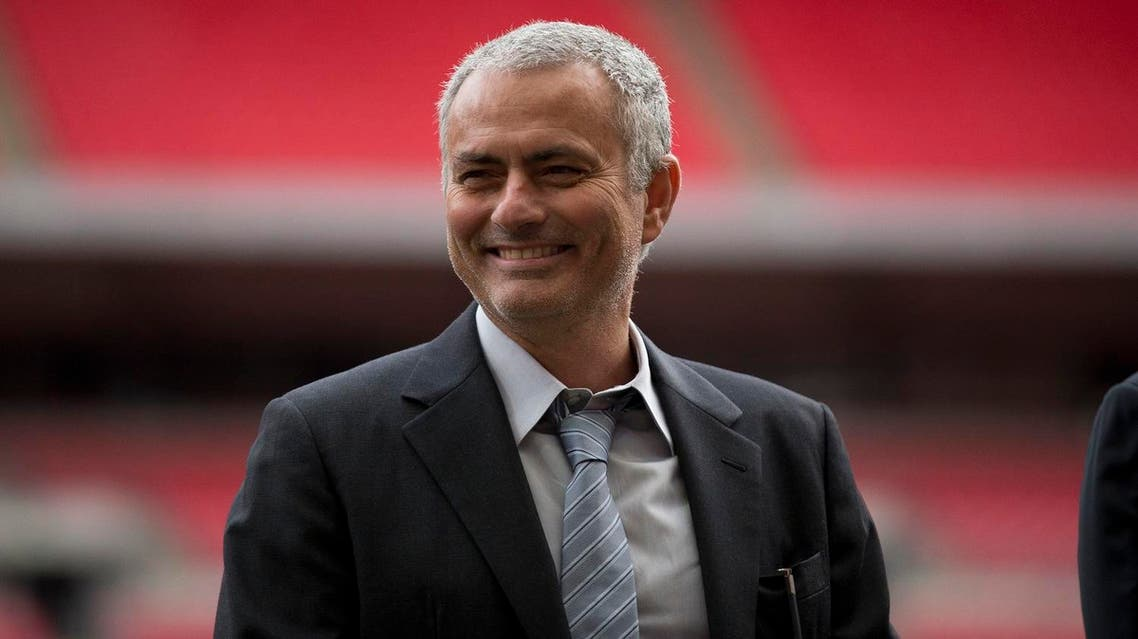 Former Chelsea manager Jose Mourinho smiles as he attends a group photo session pitchside as a guest of FIFA Presidential Candidate Gianni Infantino after unveiling his 90 day plan that he will implement if he is elected FIFA President, at Wembley Stadium in London, Monday, Feb. 1, 2016. AP