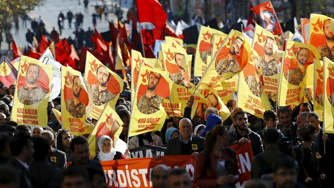 Mourners march with flags with an image of Aziz Guler during his funeral ceremony in Gazi neighborhood of Istanbul, Turkey, November 22, 2015