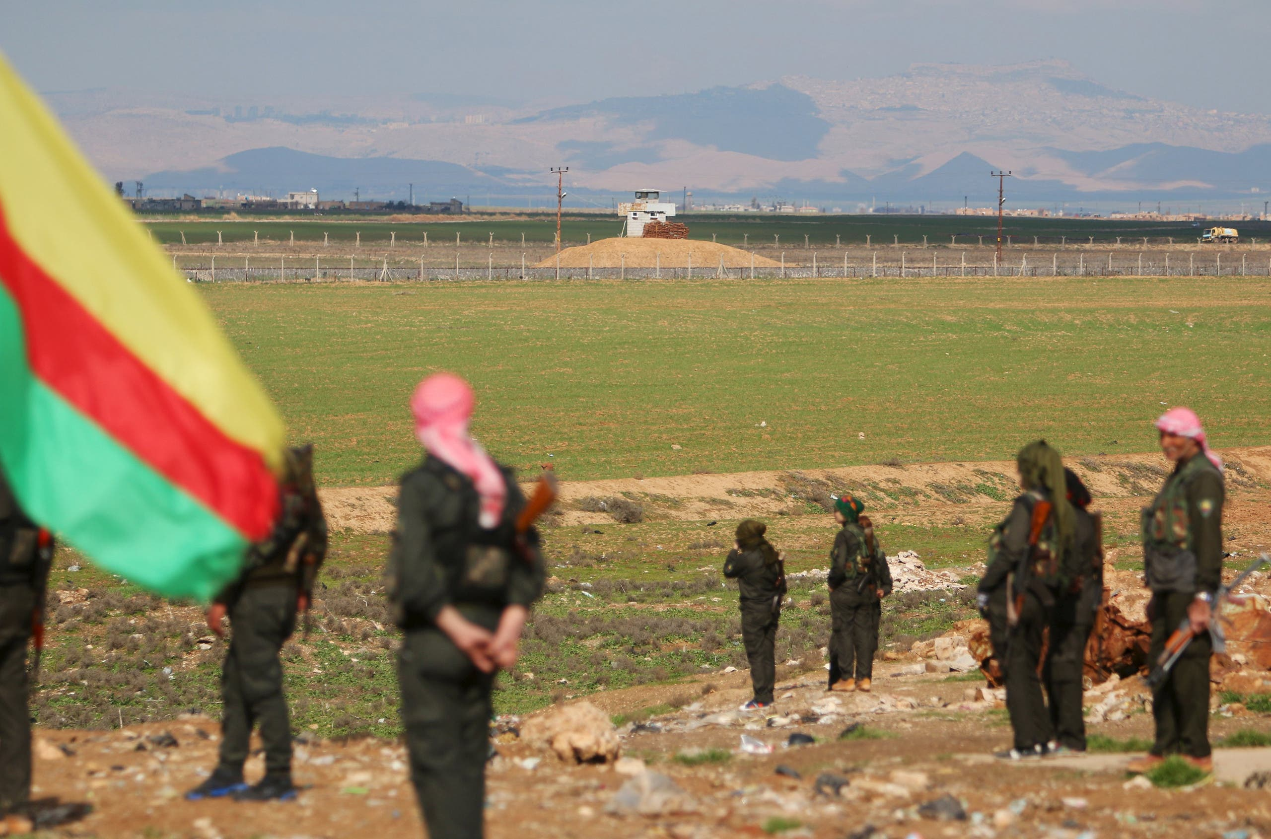 Kurdish members of the Self-Defense Forces stand near the Syrian-Turkish border in the Syrian city of al-Derbasiyah during a protest against the operations launched in Turkey by government security forces against the Kurds, February 9, 2016. REUTERS