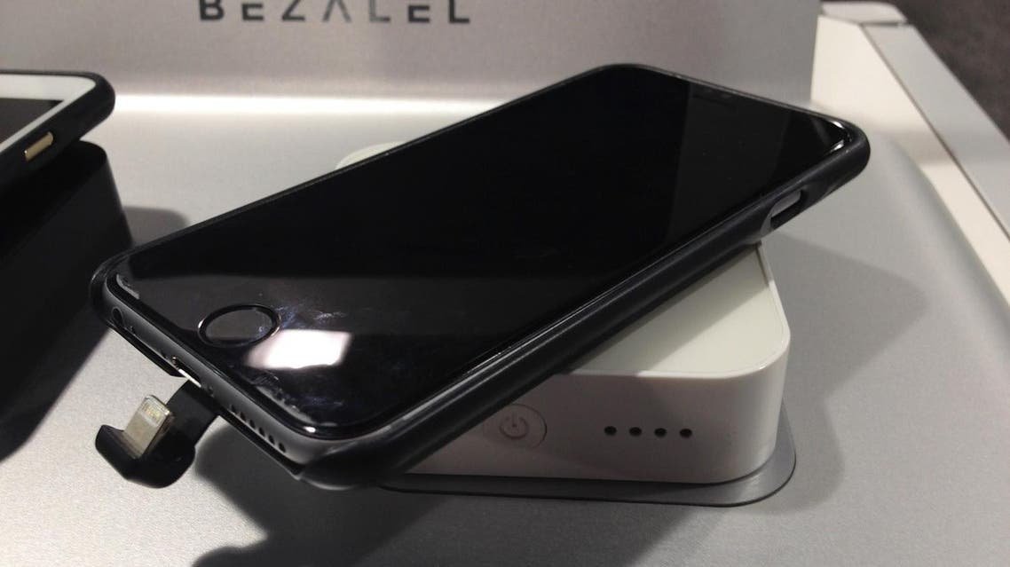 In this Thursday, Jan. 7, 2016, photo, a charging case for an iPhone 6 sits on a wireless charger, both made by Bezalel, at the Sands Expo during the CES International gadget show in Las Vegas. (AP)