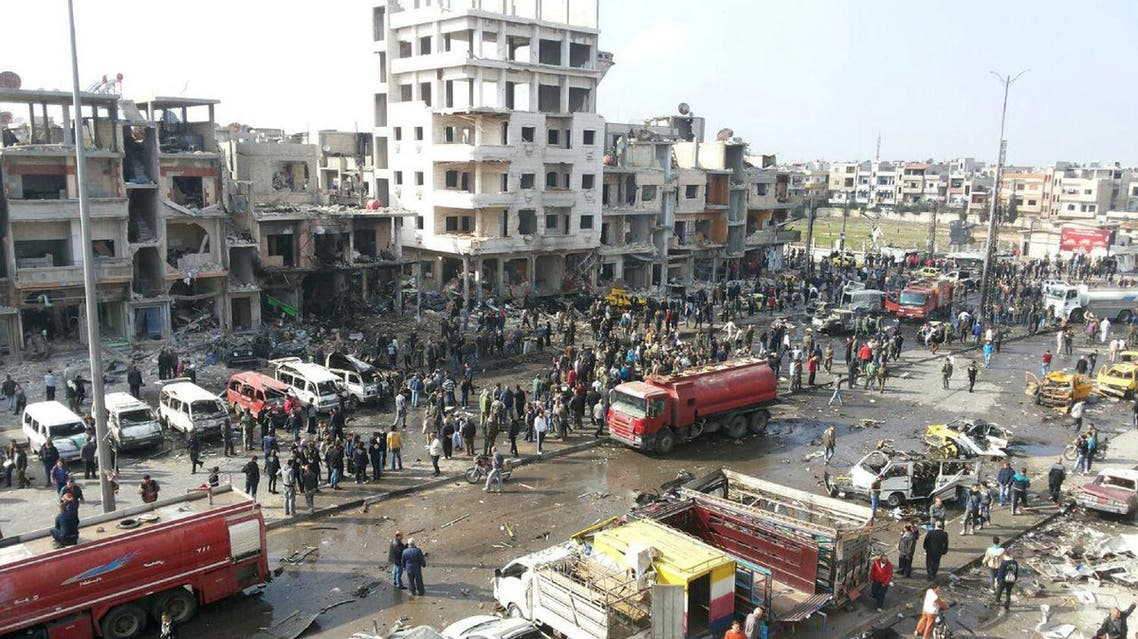 A general view shows the site of a two bomb blasts in the government-controlled city of Homs, Syria, in this handout picture provided by SANA on February 21, 2016. REUTERS