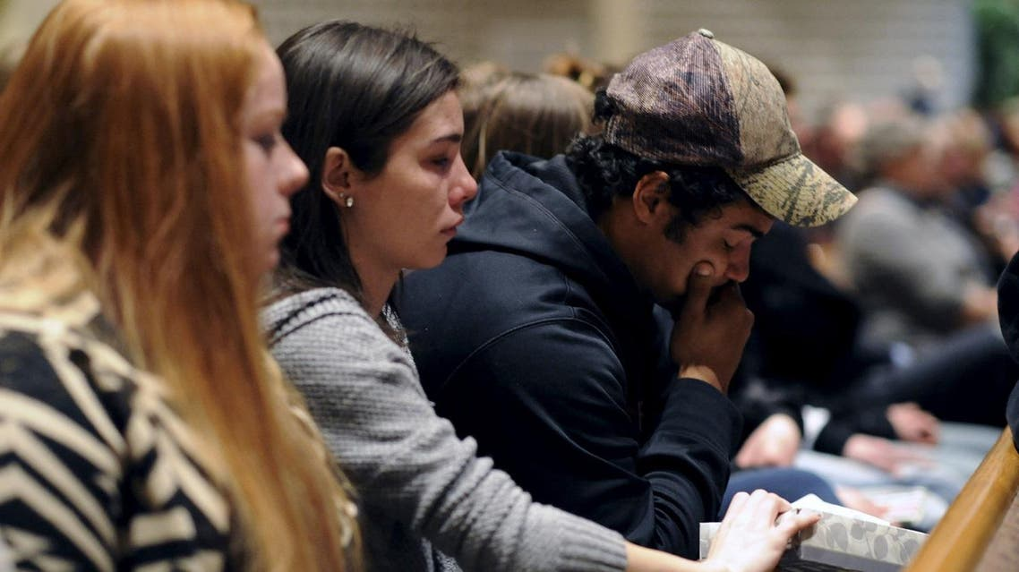 People attend a vigil after a random shooting killed six people in Kalamazoo County, Michigan, February 21, 2016. REUTERS